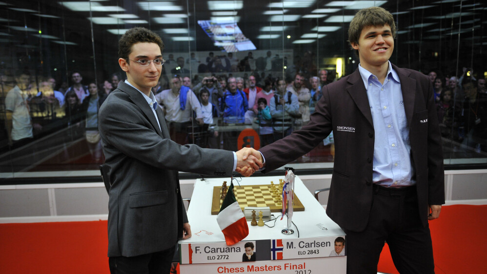 Fabian Caruana (t.v.) og Magnus Carlsen under en turnering i Spania i 2012. (AP Photo/Alvaro Barrientos)