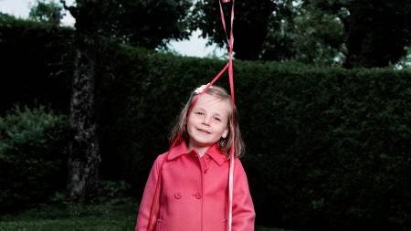 En blid prinsesse med bursdagsballonger. (Foto: NAGELSTAD, JULIA MARIE/SCANPIX)