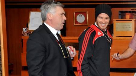 SNAKKER ENGELSK: Carlo Ancelotti og David Beckham.  (Foto: TAMAS KOVACS/EPA)
