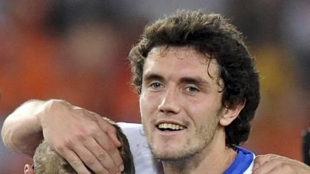 PÅ VEI TIL CHELSEA? Juri Zhirkov skal ha signert for Chelsea.   (Foto: PATRICK HERTZOG/AFP)