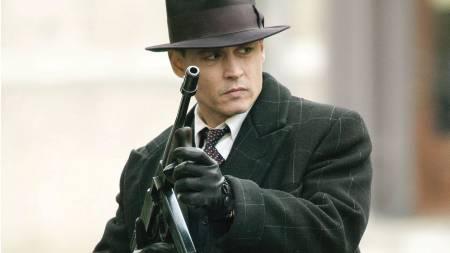 «PUBLIC ENEMY»: Johnny Depp spiller rollen som John Dillinger   i filmen om hans liv, «Public Enemy». (Foto: Peter Mountain/AP)