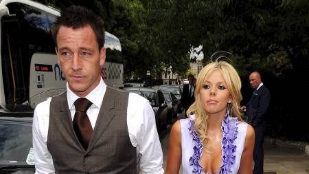 John Terry and his wife Toni arrive at the Royal Hospital in Chelsea for the wedding of Carly Zucker and Joe Cole London, England  (Foto: Scanpix/Mandatory Credit: Zibi/WENN.com)