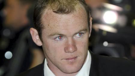 SOM PREST? Wayne Rooney ser seg selv som prest.  (Foto: Leon Neal/AFP)