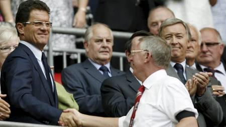BEKYMRET: Fabio Capello og Sir Alex Ferguson er bekymret for Rooneys skade. (Foto: IAN KINGTON/AFP)