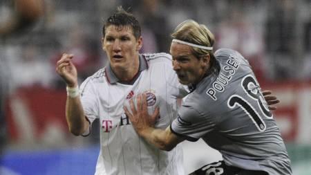Bastian Schweinsteiger, Christian Poulsen (Foto: STEFFI LOOS/AFP)