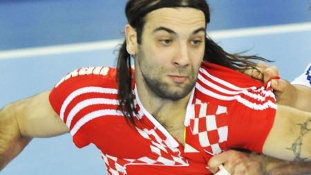 Croatia's Ivano Balic (L) vies with   France's Nikola Karabatic during their men's World   Championships final match on at the