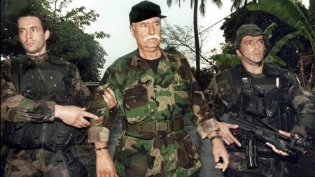 LEIESOLDAT-LEGENDE: Prosjektbeskrivelsen fra Moland og French   inneholder bilder av den franske leiesoldaten Bob Denard som var involvert   i en rekke kupp i Afrika fra 1970-tallet og fram til han ble arrestert   av franske styrker på Komorene i 1995 (bildet) (Foto: ALEXANDER JOE/AFP)