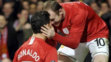 Ronaldo og Rooney (Foto: ANDREW YATES/AFP)