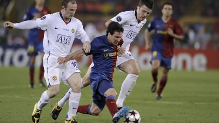 STJERNEDUELL: Messi og Rooney møttes i finalen i 2009. (Foto: FILIPPO MONTEFORTE/AFP)