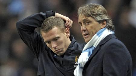 - INGEN KONFLIKT: Craig Bellamy avviser påstandene om problemer mellom ham og Roberto Mancini. (Foto: ANDREW YATES/AFP)