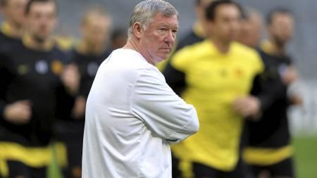 PÅ PLASS TYSKLAND: Sir Alex Ferguson og United-stjernene. (Foto:   ANDREW YATES/AFP)