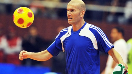 Former French national team football player Zinedine Zidane   plays the ball during a friendly indoor soccer match between the Algeria   team of 1982 and the French team of 1998 at la Coupole indoor stadium,   on March 1, 2010 in Algiers. AFP PHOTO / FAYEZ NURELDINE
