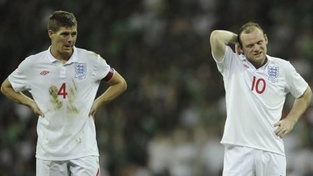 MEST POPULÆRE: Steven Gerrard og Wayne Rooney har flest fans. (Foto: Tom Hevezi/Ap)