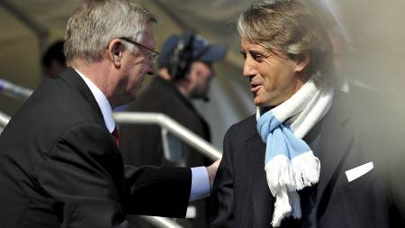 FÅR SKRYT AV FERGUSON: Roberto Mancini hylles av Sir Alex Ferguson. (Foto: Martin Rickett/Pa Photos)