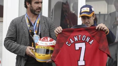 Eric Cantona, Fernando Alonso (Foto: TOM HEVEZI/AP)