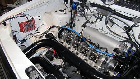 Turbo-utgaven av Dodge Caravan og Plymouth Voyager var i utgangspunktet   ikke voldsomt sprek. Men under dette panseret har det skjedd mye. Foto:   Turbo-Mopar.com