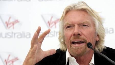 PENGEMAGNET: Sir Richard Branson leter etter nye måter å tjene penger på. Denne gangen vil ha ha britiske banker. (Foto: TORSTEN BLACKWOOD/Afp)