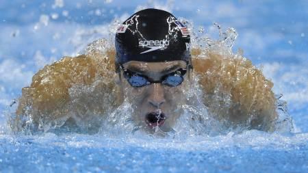 GULLGROSSIST: Men snart skal Michael Phelps legge opp. (Foto: MARK RALSTON/Afp)