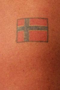 NORSK HYLLEST: Peter Mueller angrer ikke på sitt norske flagg, som er tatovert på overarmen.