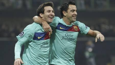 Messi og Xavi (Foto: Luca Bruno/Ap)
