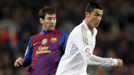 Lionel Messi og Cristiano Ronaldo - de to beste fotballspillerne i verden akkurat nå. (Foto: ALBERT GEA/Reuters)