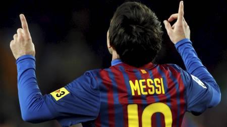 TIDENES TOPPSCORER: Lionel Messi scoret tre mål mot Granada og er nå tidenes mestscorende Barcelona-spiller. (Foto: ALBERT GEA/Reuters)