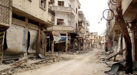 STORE ØDELEGGELSER: Opposisjonen i Syria offentliggjorde dette bildet fredag 30. mars som angivelig viser ødeleggelsene i bydelen Bab al-Sebaa i Homs.  (Foto: Afp)