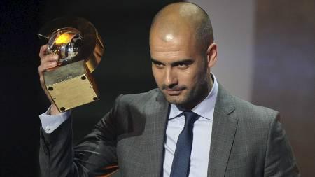 ÅRETS TRENER: Pep Guardiola. (Foto: FABRICE COFFRINI/Afp)