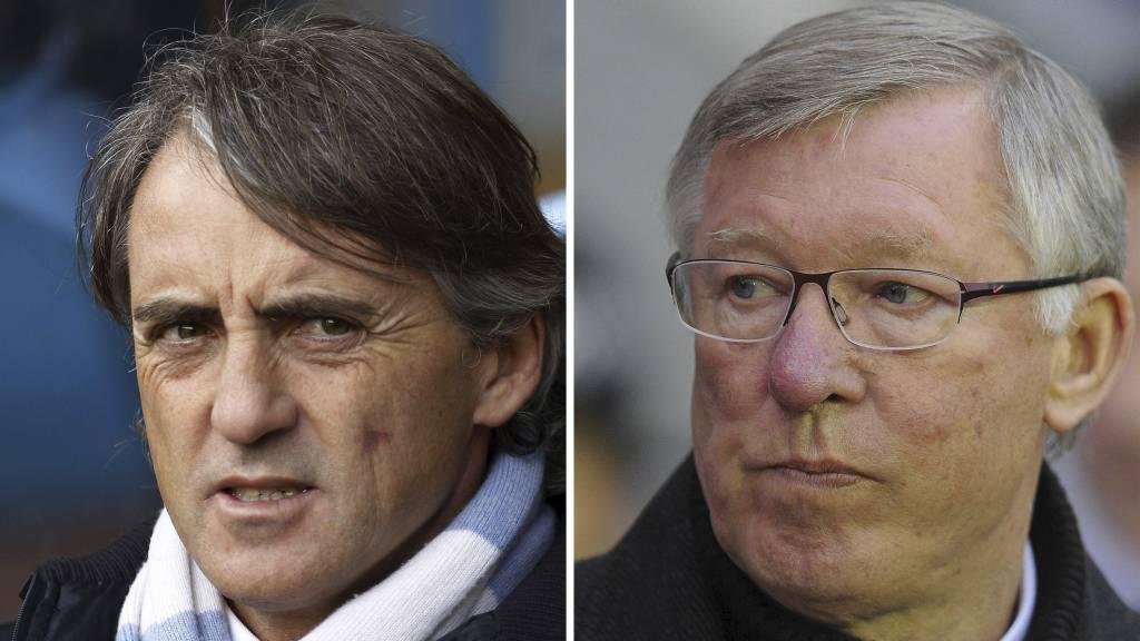 TJENER BEDRE: Roberto Mancini går forbi Sir Alex Ferguson i grunnlønn. (Foto: IAN KINGTON/Afp)