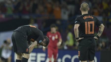 Robin van Persie og Wesley Sneijder (Foto: FILIPPO MONTEFORTE/Afp)