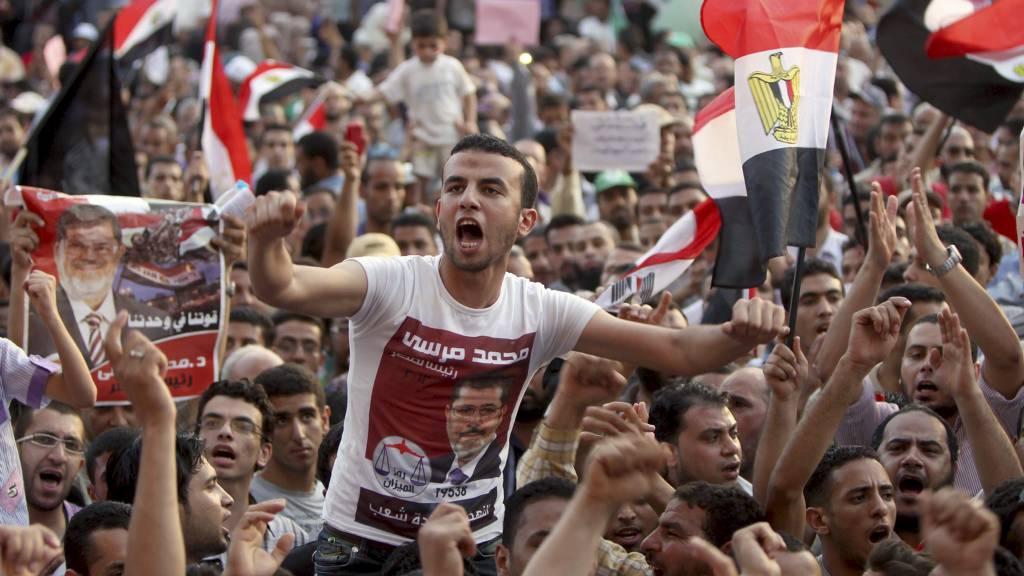 SYNGER UT: Tusenvis av demonstrantene er tilbake på Tahrir-plassen i Kairo. (Foto: MARWAN NAAMANI/Afp)