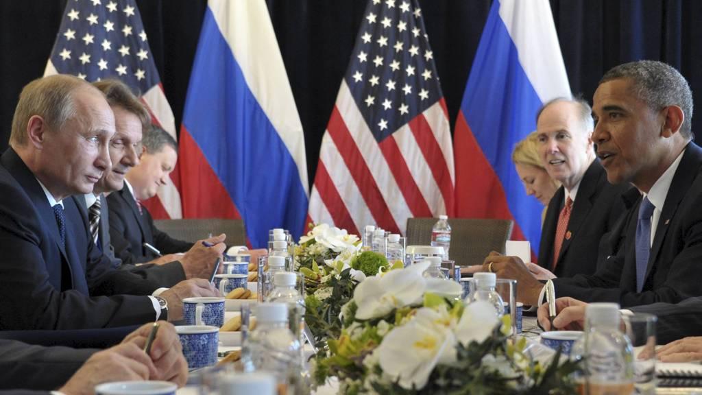 SNAKKET OM SYRIA: Vladimir Putin og Baracj Obama på G20-møte i Mexico. Stormaktlederne diskuterte løsninger i Syria. (Foto: RIA NOVOSTI/Reuters)
