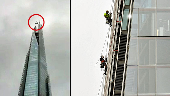 HENGER HØYT: Den stakkars vindusvaskeren slapp fra det med skrekken da vinden tok tak i stillaset hvor han sto på toppen av skyskraperen «The Shard» i London. (Foto: Matt King/John Stillwell, Pa Photos)