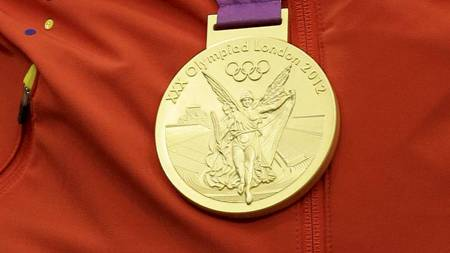 Gullmedaljen (Foto: Rebecca Blackwell/Ap)