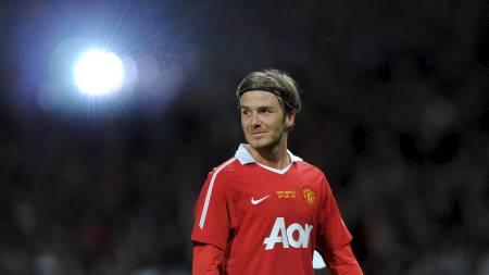 UNITED-LEGENDE: David Beckham er United-supporter på sin hals. Det er ikke sønnen Romeo. (Foto: ANDREW YATES/Afp)