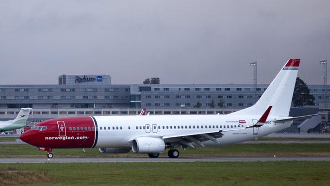Det blir ikke streik etter at de kabinansatte og Norwegian kom til enighet på overtid natt til onsdag. Flyene går dermed som normalt fra onsdag morgen.  (Foto: Paul Kleiven / NTB scanpix)
