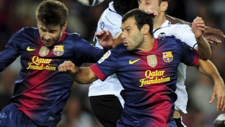 NOMINERT: Gerard Pique og Barcelonas Javier Mascherano er begge nominert til verdenslaget. (Foto: OLIVIER MORIN/Afp)