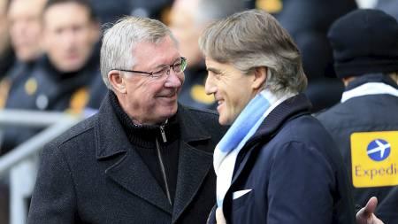 GOD STEMNING FØR KAMPSTART: Både Sir Alex Ferguson og Roberto Mancini var ved godt mot, men etter kampslutt var de noe mer uenige. (Foto: Mike Egerton/Pa Photos)