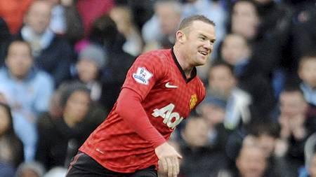 Wayne Rooney jubler (Foto: Clint Hughes/Ap)