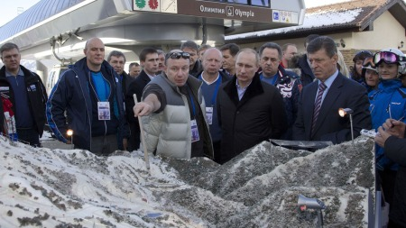 Russian President Vladimir Putin (3rd R) listens to Interros Investment Company President Vladimir Potanin ((2nd L) during a visit to the Rosa Khutor Alpine Centre, one of the Sochi 2014 Winter Olympic venues, near the Black Sea city of Sochi, on February 6, 2013