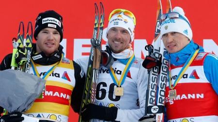 VANT GENERALPRØVEN: Johan Olson slo til med seier i Davos under helgens verdenscuprenn. Svensken slo både Dario Cologna og Alexander Legkov på 15 kilometer fri teknikk. (Foto: Arno Balzarini, ©AB ASU LG**BRL**)