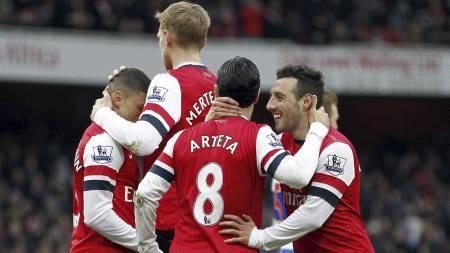 KANONGLADE: Arsenal etter å ha sikret seg 4-1 over Reading. (Foto: IAN KINGTON/Afp)