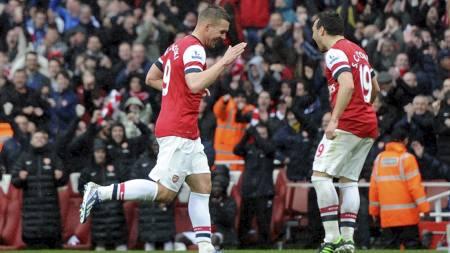 AVGJORDE: Lukas Podolski sitt 3-1-mål ble spikeren i kisten. (Foto: Anthony Devlin/Pa Photos)