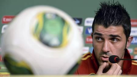 AVVISER KONFLIKT: På en pressekonferanse i Brasil avviser David Villa at det finnes en konflikt mellom ham og Torres. (Foto: LLUIS GENE/Afp)