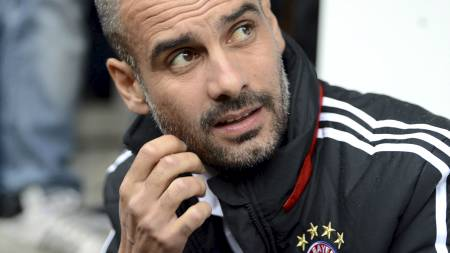 IRRITERT: Pep Guardiola er irritert på ledelsen i gamleklubben   Barcelona. (Foto: ARMIN WEIGEL/Afp)
