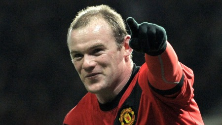 HAN ER KJENT, HAN HAR VÆRT DER FØR: Wayne Rooney jubler for scoring mot Wigan i desember 2009. (Foto: ANDREW YATES, AFP)