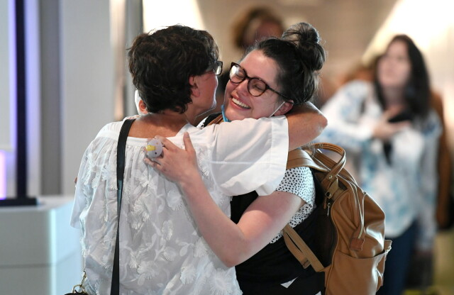 HUSBAND: Family residences at Brisbane, Australia's airport can be reunited with Hughes, the country after removing the country's most restrictive sanctions in December.  Photo: Dave Hunt / Reuters