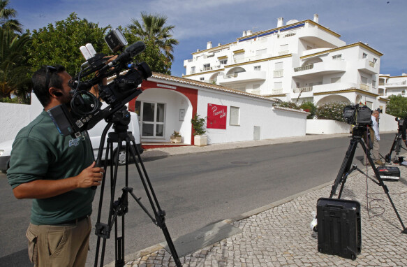 PRESS RELEASE: A cameraman stands outside the Ocean Club in Praia da Luz in Portugal on October 14, 2013 after Madeleine McCann disappeared.
