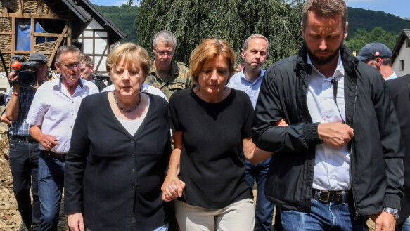 Chancellor Angela Merkel joined hands with Rhineland-Palatinate Governor Malu Trayer to walk through the flood-ravaged village.