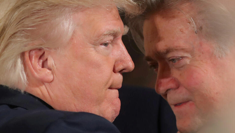 FILE PHOTO:  U.S. President Donald Trump talks to chief strategist Steve Bannon during a swearing in ceremony for senior staff at the White House in Washington, U.S. January 22, 2017. REUTERS/Carlos Barria/FILE PHOTO     TPX IMAGES OF THE DAY